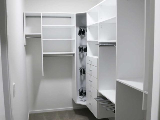 small walk-in-wardrobe—2-x-pant-racks